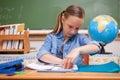 Schoolgirl doing classwork Royalty Free Stock Photo