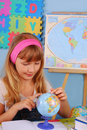 Schoolgirl on geography lesson Royalty Free Stock Image