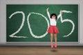 Schoolgirl jump in class with number 2015