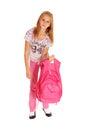 Schoolgirl lifting heavy backpack. Royalty Free Stock Photo
