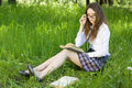 Schoolgirl in park read book Royalty Free Stock Photos