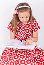 Schoolgirl reading book cute casual Stock Image