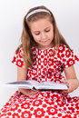 Schoolgirl reading book cute casual Stock Photo