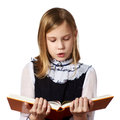 Schoolgirl reading book Royalty Free Stock Photo