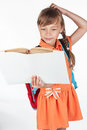 Schoolgirl reading a textbook Royalty Free Stock Photo
