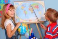 Schoolgirl  and schoolboy on geography lesson Royalty Free Stock Image