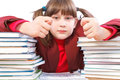 Schoolgirl schoolwork and stack of books unwilling to do shows fig Royalty Free Stock Photos