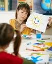 Schoolgirl showing painting in art class Stock Image