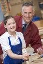 Schoolgirl and teacher in woodwork class Royalty Free Stock Photo
