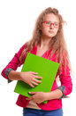 Schoolgirl teen girl serious in glasses holding a folder for papers portrait isolated on white background Royalty Free Stock Photo
