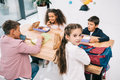 Schoolkids eating lunch while sitting together at table Royalty Free Stock Photo
