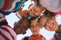 Schoolkids forming huddle in campus Royalty Free Stock Photo