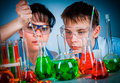 Schoolteacher and student working in the lab Royalty Free Stock Image