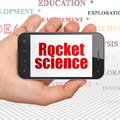 Science concept: Hand Holding Smartphone with Rocket Science on display Royalty Free Stock Photo