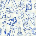 Science doodles seamless pattern on school squared paper Royalty Free Stock Photo