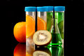 Science lb tubes filed with liquid of with fruits parts on black background Royalty Free Stock Image