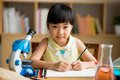 Science lesson vietnamese little girl drawing at the Stock Photos
