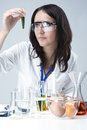 Science and Medicine Concepts. Portrait of Female Lab Staff Dealing With Flasks and Substances in Laboratory Royalty Free Stock Photo