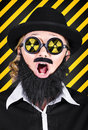 Science research geek with atomic discovery wearing nuclear symbol on glasses expressing shock in an mad scientist concept Royalty Free Stock Photo