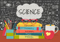 SCIENCE in speech bubbles above science books, pens box,apple and mug with science doodles on chalkboard background. Royalty Free Stock Photo