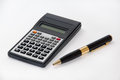 Scientific calculator and golden pen Royalty Free Stock Photos