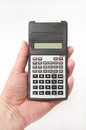 Scientific calculator in hand over white background Stock Images