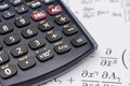 Scientific calculator and mathematical equations Royalty Free Stock Photo