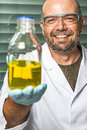 Scientific laboratory presents liquid technician its chemical results Royalty Free Stock Photos