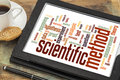 Scientific method word cloud on a digital tablet with a cup of coffee Royalty Free Stock Photos