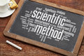 Scientific method word cloud on a vintage slate blackboard with a cup of coffee Stock Photos
