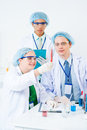 Scientific research vertical image of young interns making in the modern laboratory Royalty Free Stock Images