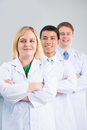 Scientific team vertical portrait of a professional smiling and looking at camera Stock Image