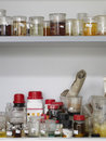 Scientific tools with liquid displayed in shelves at laboratory Stock Images