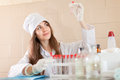 Scientific worker with test tubes in laboratory Stock Images