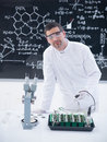 Scientist analyzing plants in lab close up of a a chemistry conducting a seedlings experiment on a table with tools and a Royalty Free Stock Images