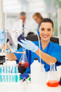 Scientist chemistry laboratory cheerful female in a Royalty Free Stock Photo