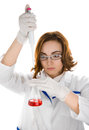 Scientist with flask focus on flask chemist red sample of liquid Stock Photo
