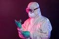 Scientist In Hazmat Suit Holdi...