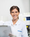 Scientist holding clipboard in laboratory portrait of female Royalty Free Stock Photos