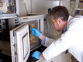 Scientist prepares chromatograph oven Stock Photography