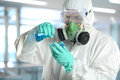 Scientist in protective clothing working laboratory Stock Photos