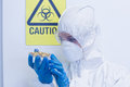 Scientist in protective suit with sprouts in laboratory close up of a the Stock Image