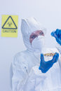 Scientist in protective suit with sprouts in laboratory close up of a the Royalty Free Stock Photos