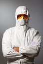 Scientist in protective wear glasses and respirator Stock Photo
