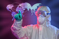 Scientist touching screen where ebola virus started in hazmat suit and protective gear pointing at origin of Stock Image