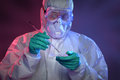 Scientist working with virus in hazmat suit and protective gear on petri dish Stock Photography