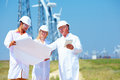 Scientists discussing project on wind power station team of Stock Image