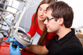 Scientists working with big magnifier Royalty Free Stock Image
