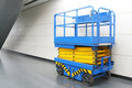 Scissor lift at indoor place Royalty Free Stock Image