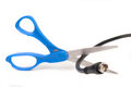 Scissors cutting through a coaxial RG6 cable Royalty Free Stock Photo